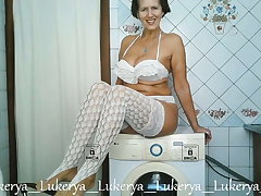 Lukerya teases with her body at home in the kitchen