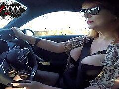 British mature Red fingers her cunt in the car again